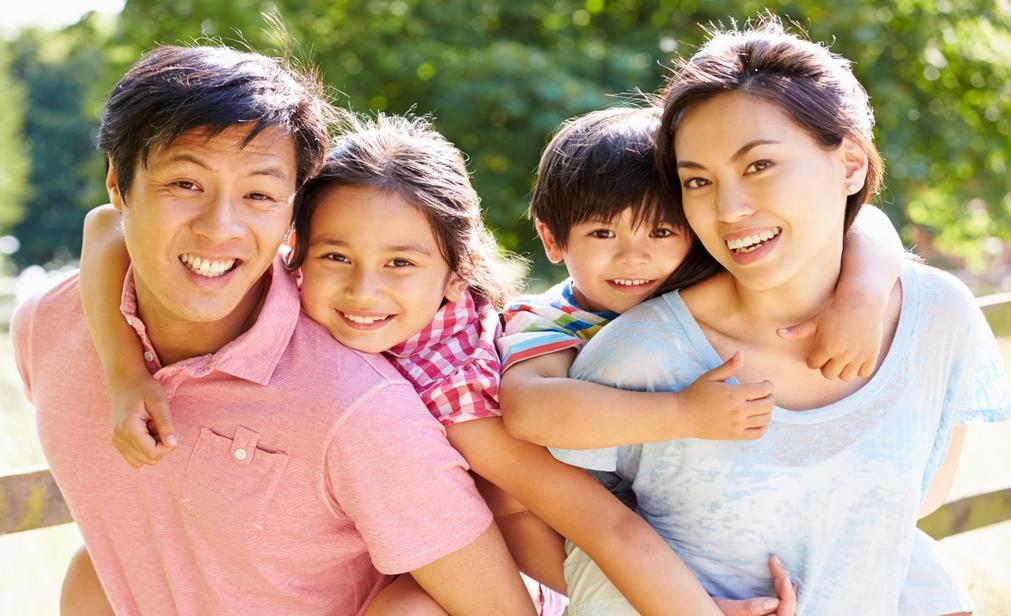Asian family of four smiling