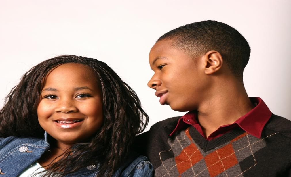Young boy and girl smiling