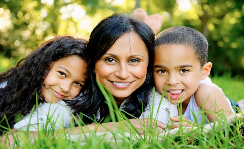 Woman and two children smiling